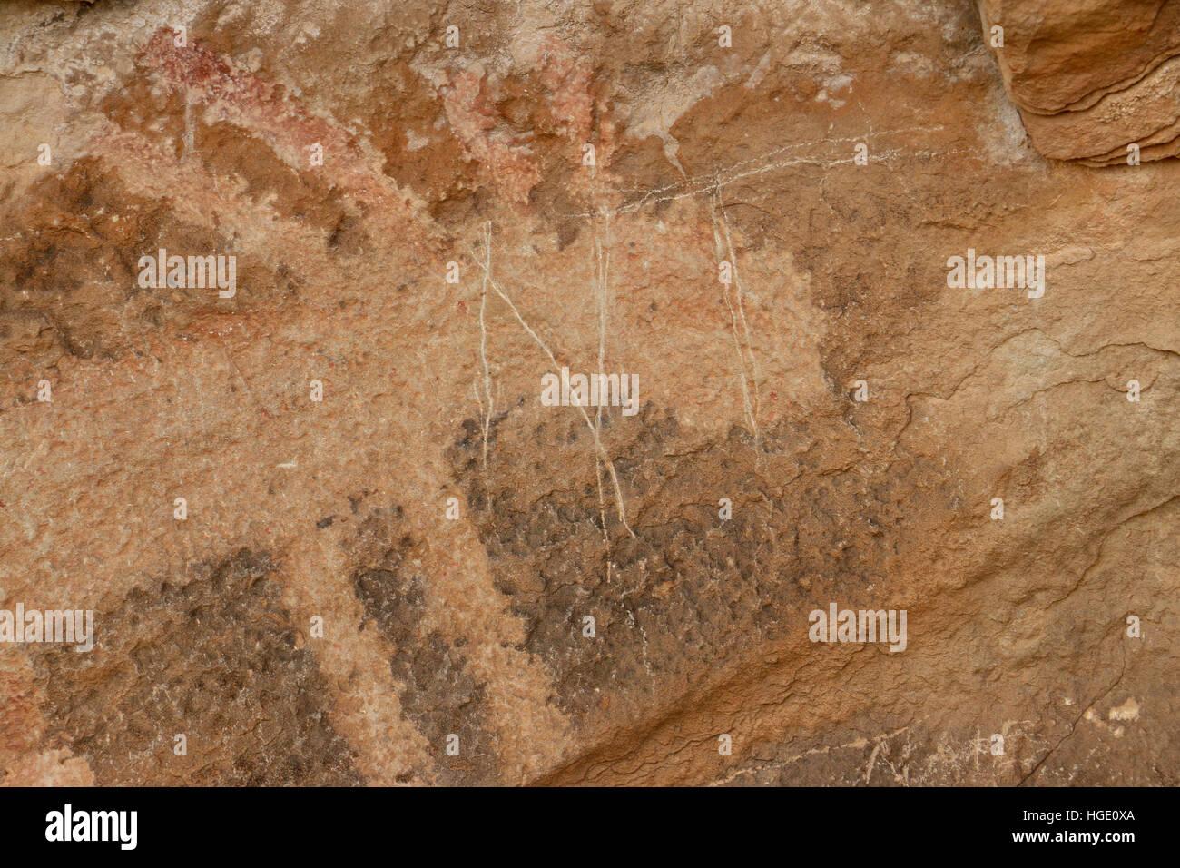 damage vandalism on Petroglyph sandstone rock Dinosaur National Monument Utah - Stock Image