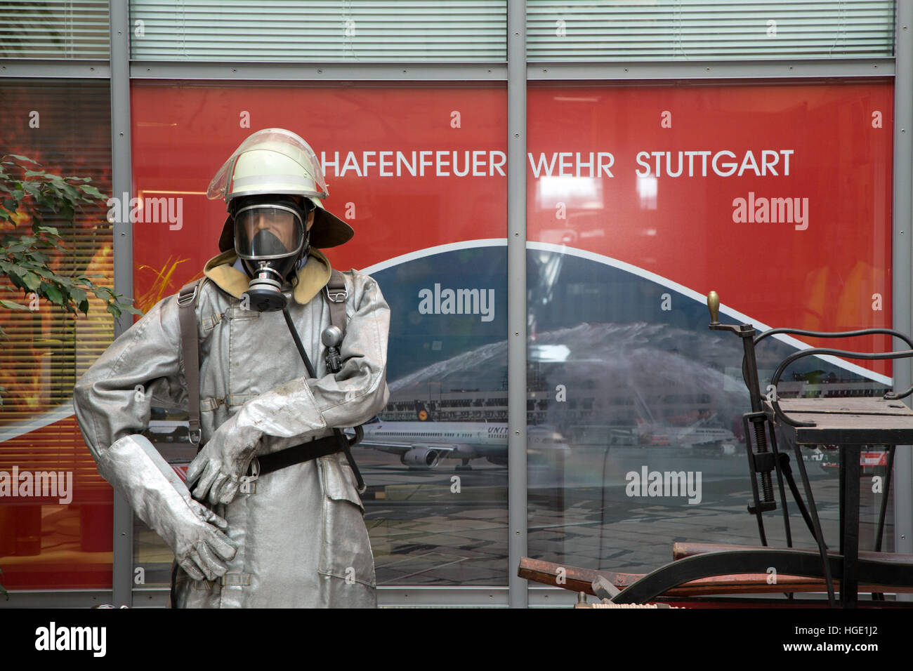 A model wearing breathing aparatus at the fire station at Stuttgart Airport in Stuttgart, Germany. - Stock Image