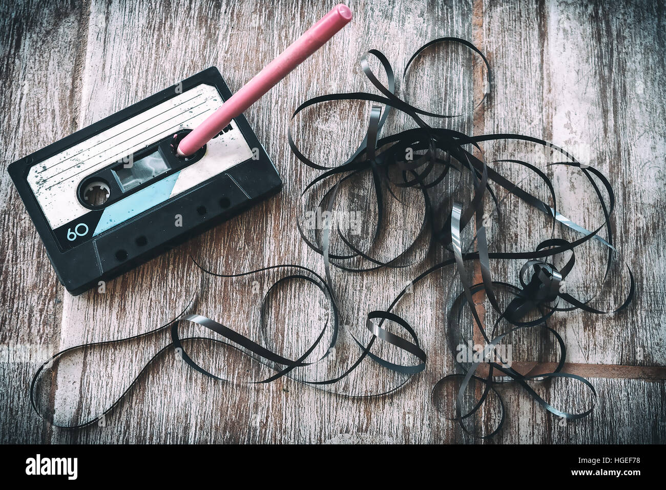 roll audio tape pencil vintage background - Stock Image