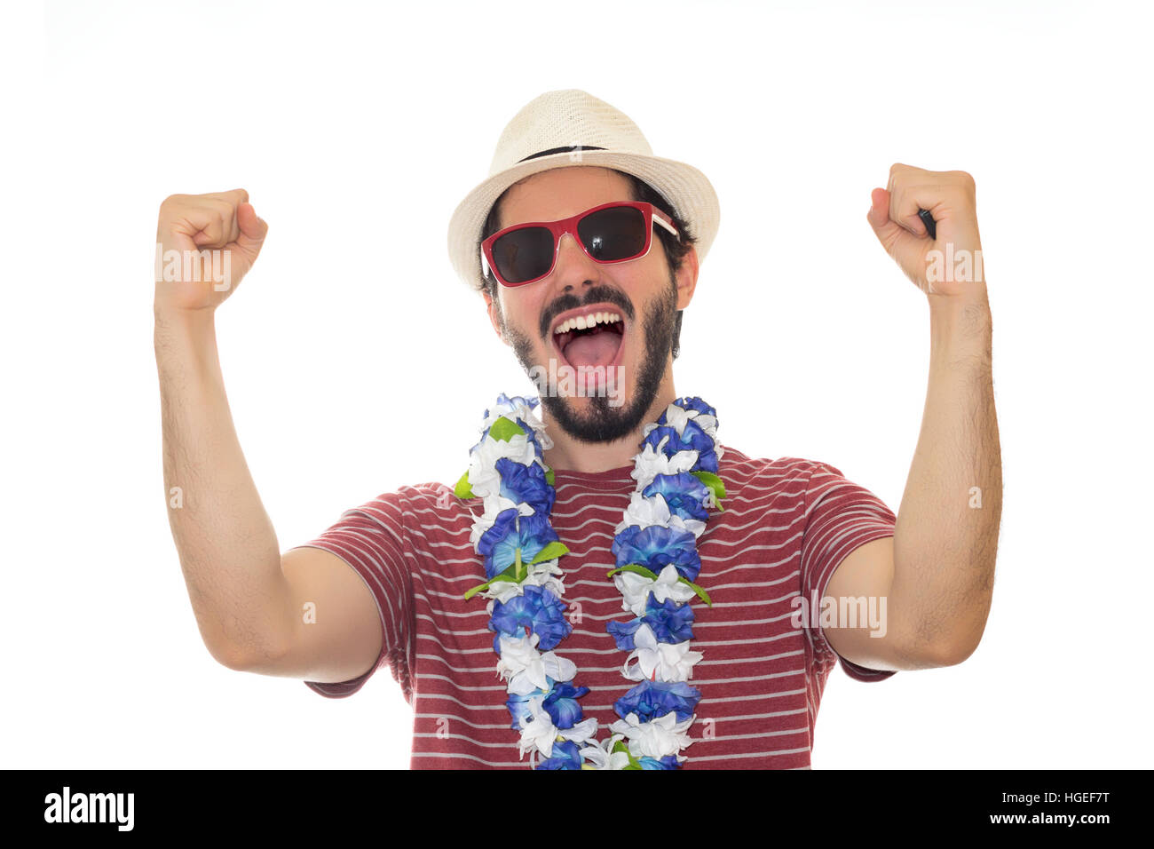Party man prepared for the carnival. Wearing sunglasses, hat and flower necklace. White background. - Stock Image