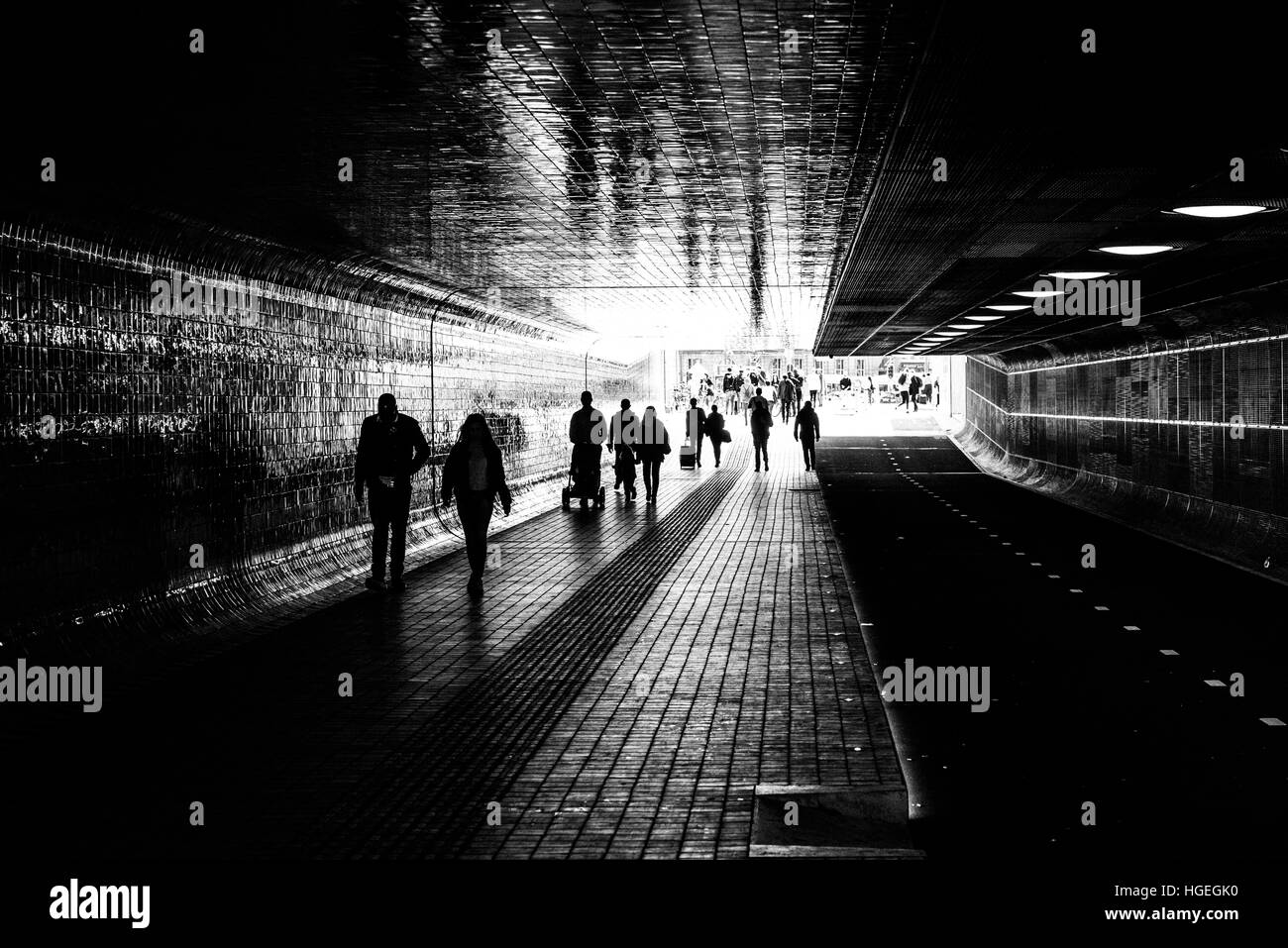 Amsterdam Central Station tunnel with people walking - Stock Image