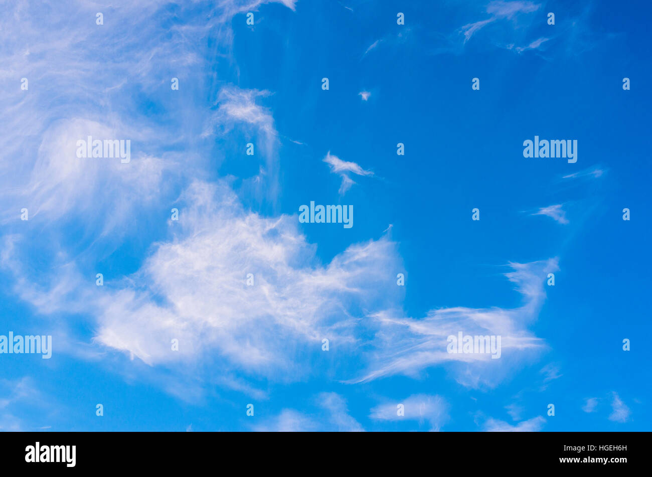 Cirrus and alto-stratus clouds in a blue sky Stock Photo