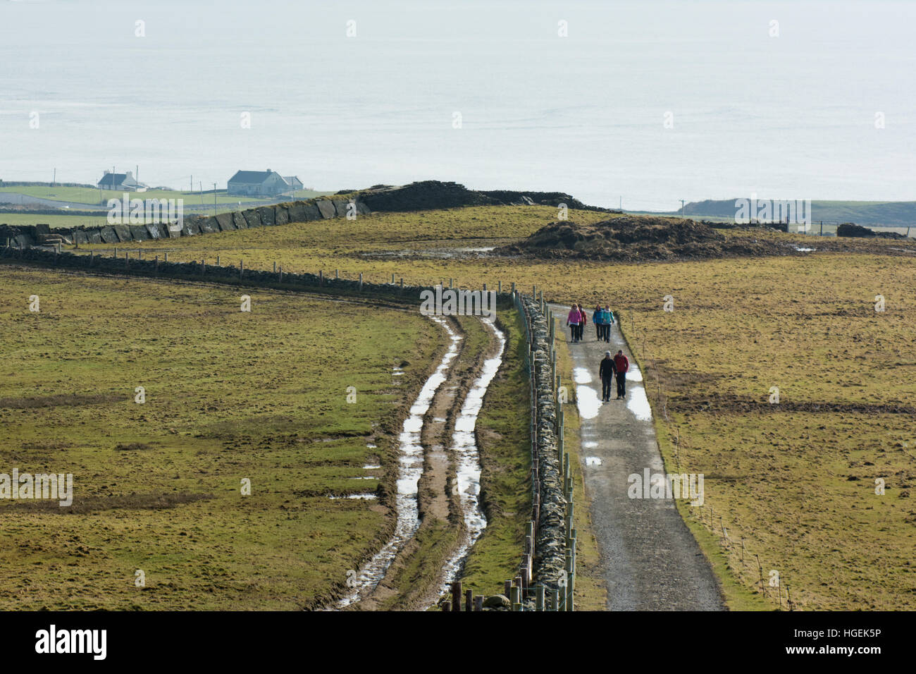 Walkers at the start of the Cliffs of Moher coastal walk near Liscannor in Clare, Ireland - Stock Image