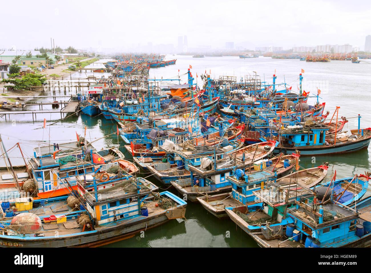 Anchored fishing boats, prediction of oncoming typhoon. - Stock Image