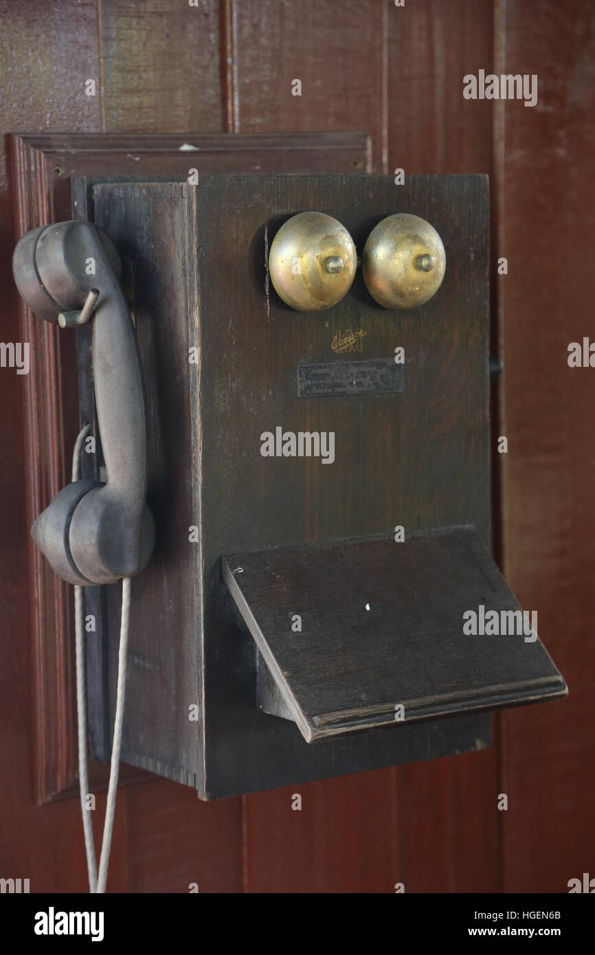Very old-fashion wooden telephone. It was made by wood, not wireless. Ring-ring telephone. - Stock Image