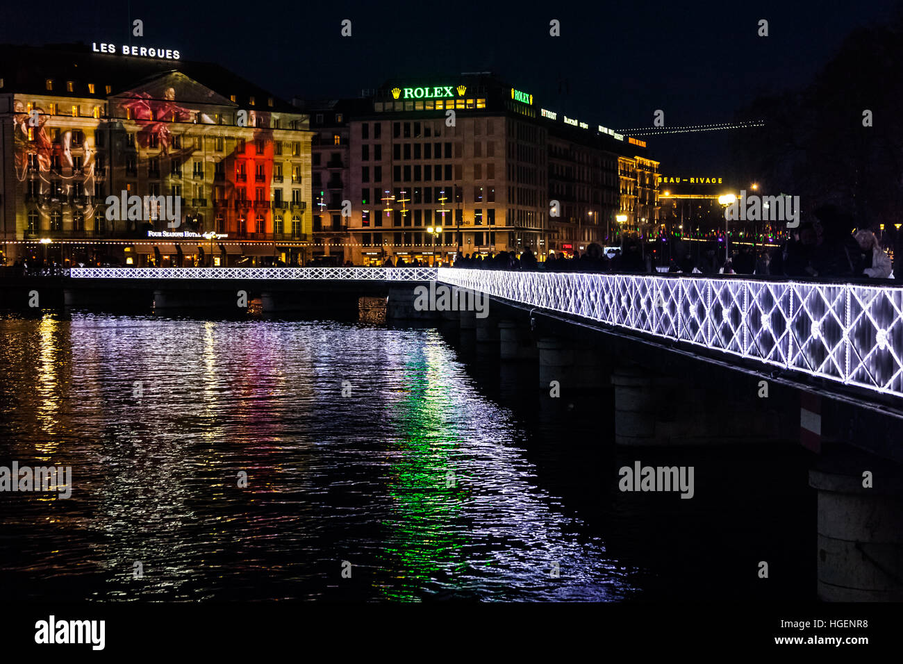 Christmas illuminations in Geneva with reflections on the lake - Stock Image
