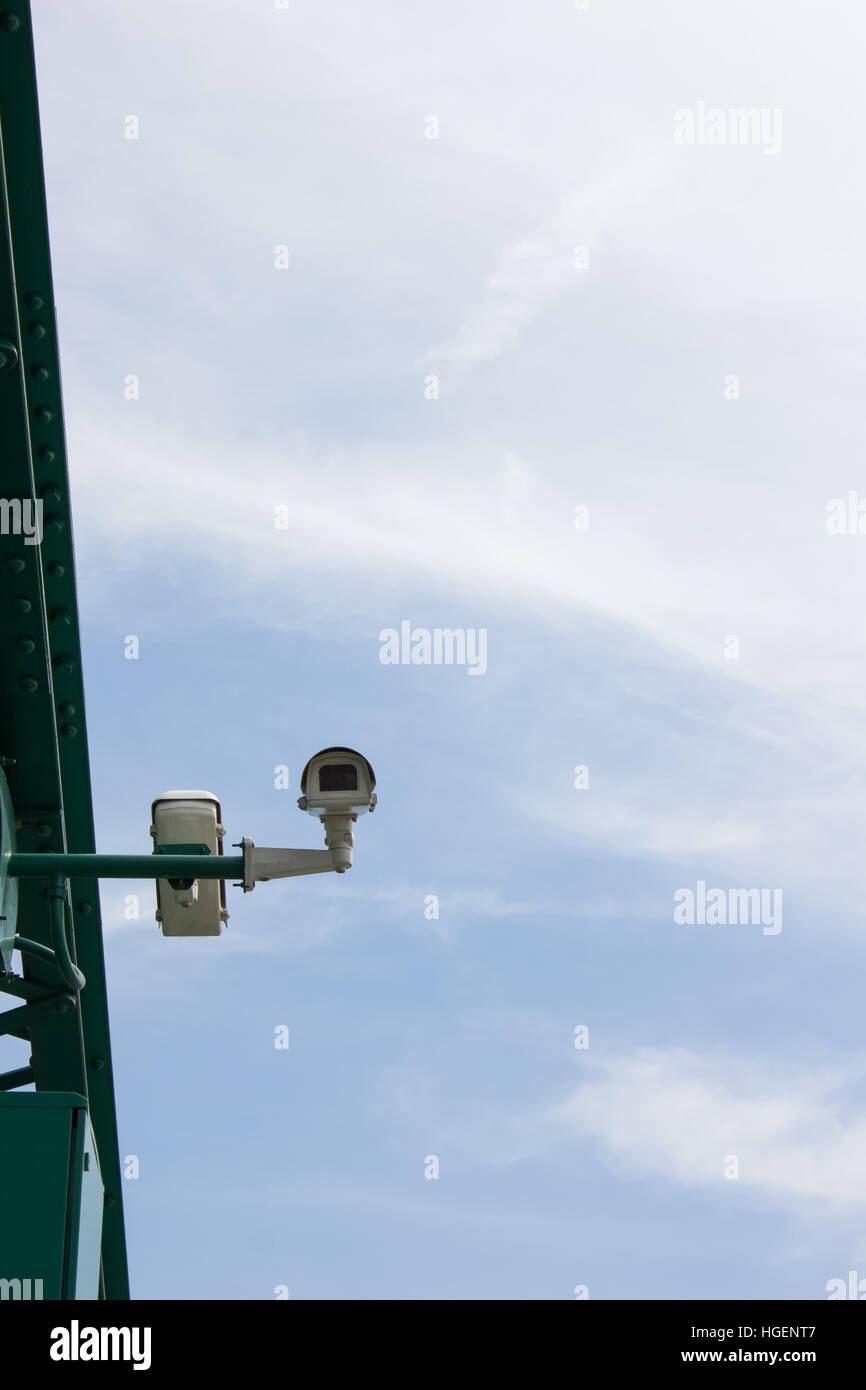 Colour picture of surveillance cameras on blue background - Stock Image