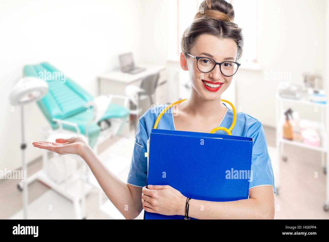 Doctor in gynecological office - Stock Image