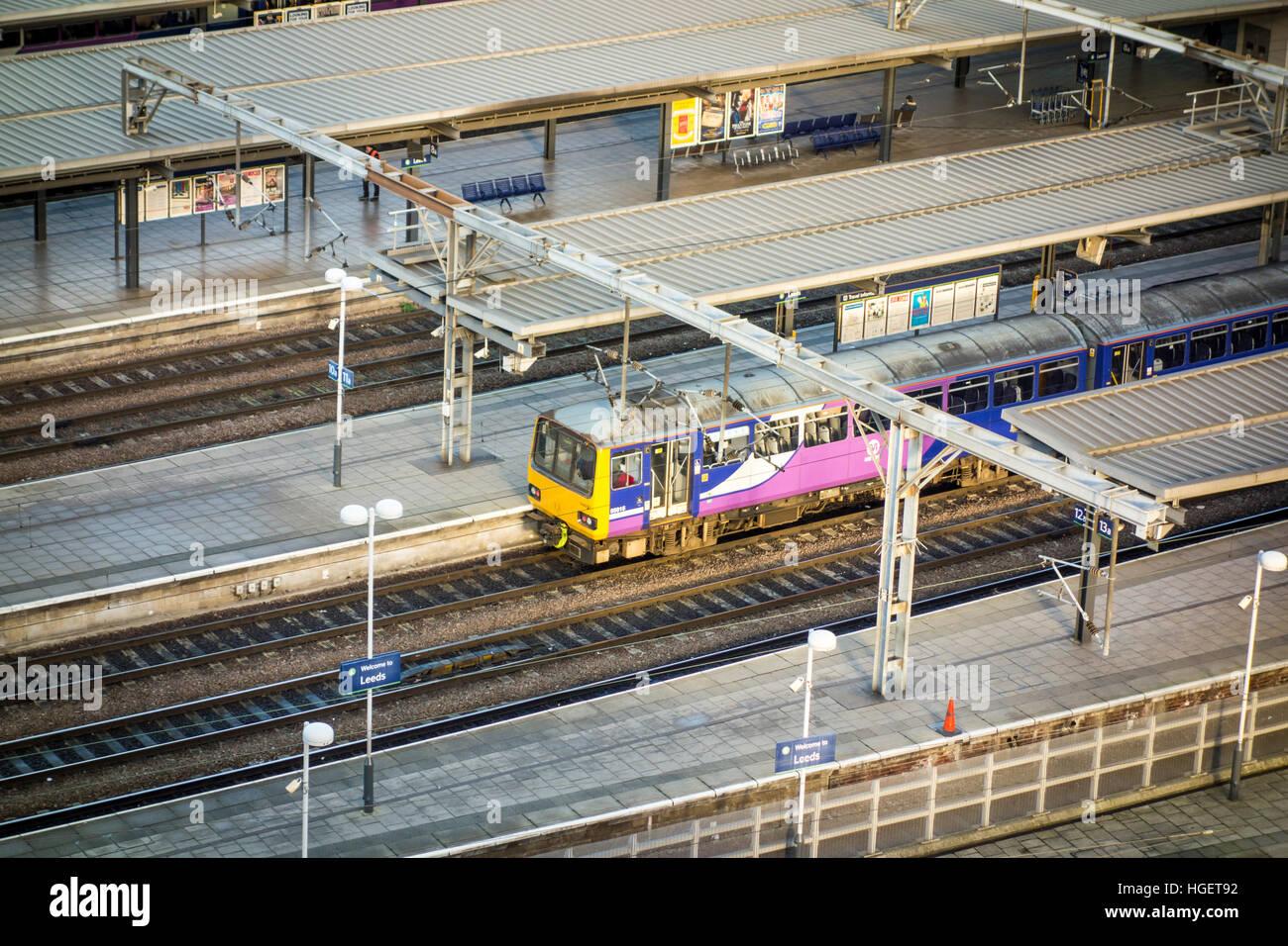 Pacer train sat at a platform in Leeds Station. - Stock Image