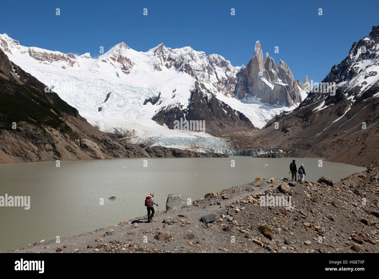 Hikers walking by Laguna Torre with view of Cerro Torre, El Chalten, Patagonia, Argentina, South America - Stock Image