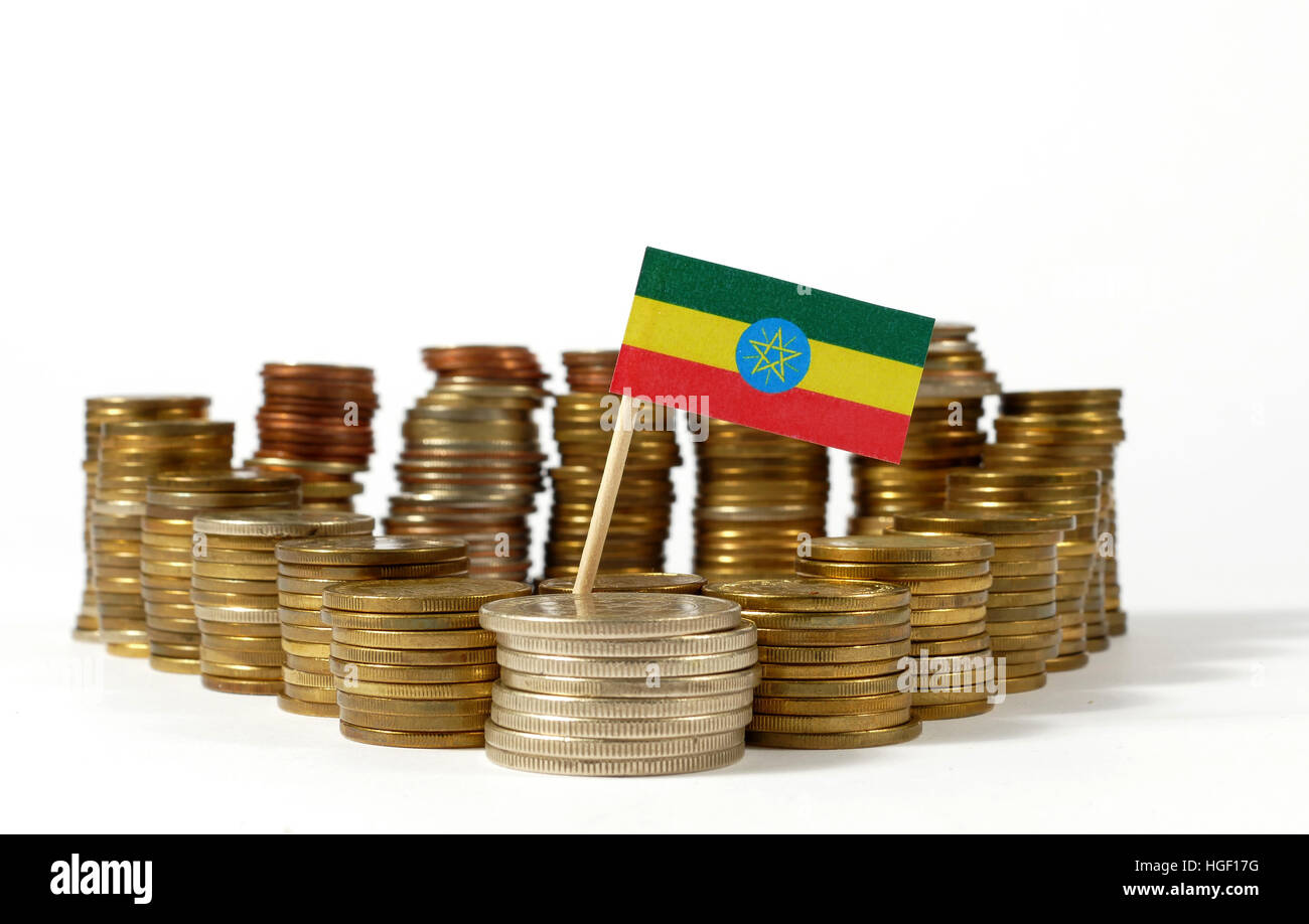 Ethiopia flag waving with stack of money coins - Stock Image