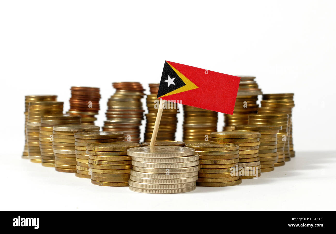East Timor flag waving with stack of money coins - Stock Image