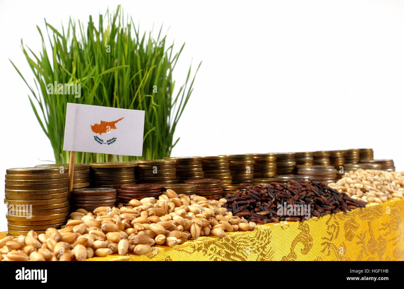 Cyprus flag waving with stack of money coins and piles of wheat and rice seeds - Stock Image