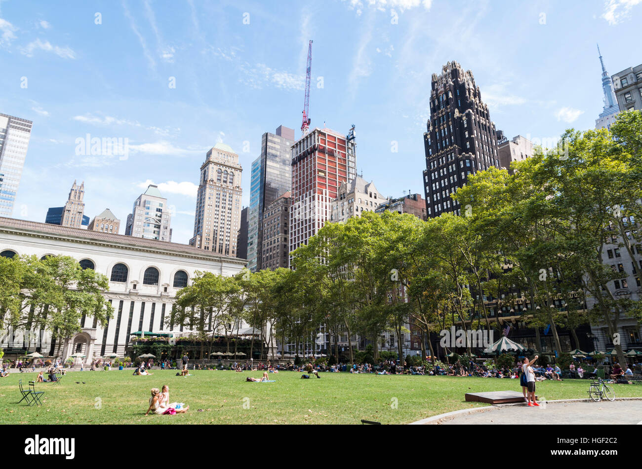 View across the Great Lawn in Bryant Park, New York, in Summer with the Bryant Park Hotel in the background - Stock Image