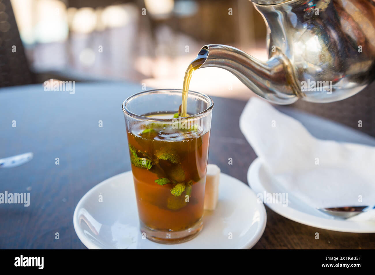 Traditional mint tea, also known as Berber whiskey. Teahouse in Sidi Ifni, Morocco. Stock Photo