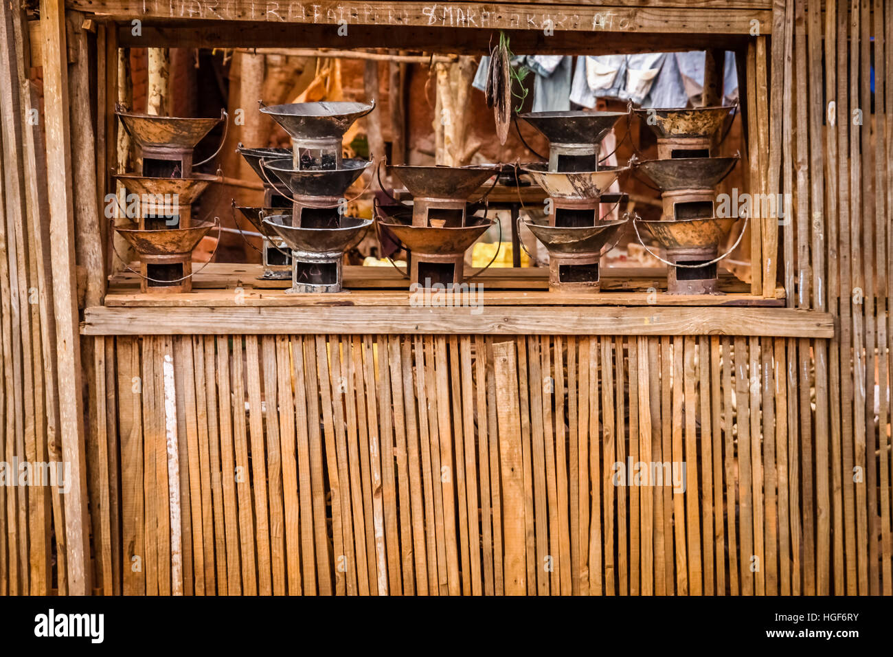 Primitive metal stoves for sale on the market in small malagasy village - Stock Image