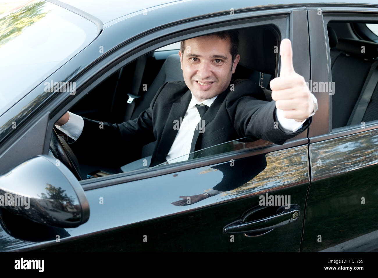 Man very happy after purchasing his new car - Stock Image