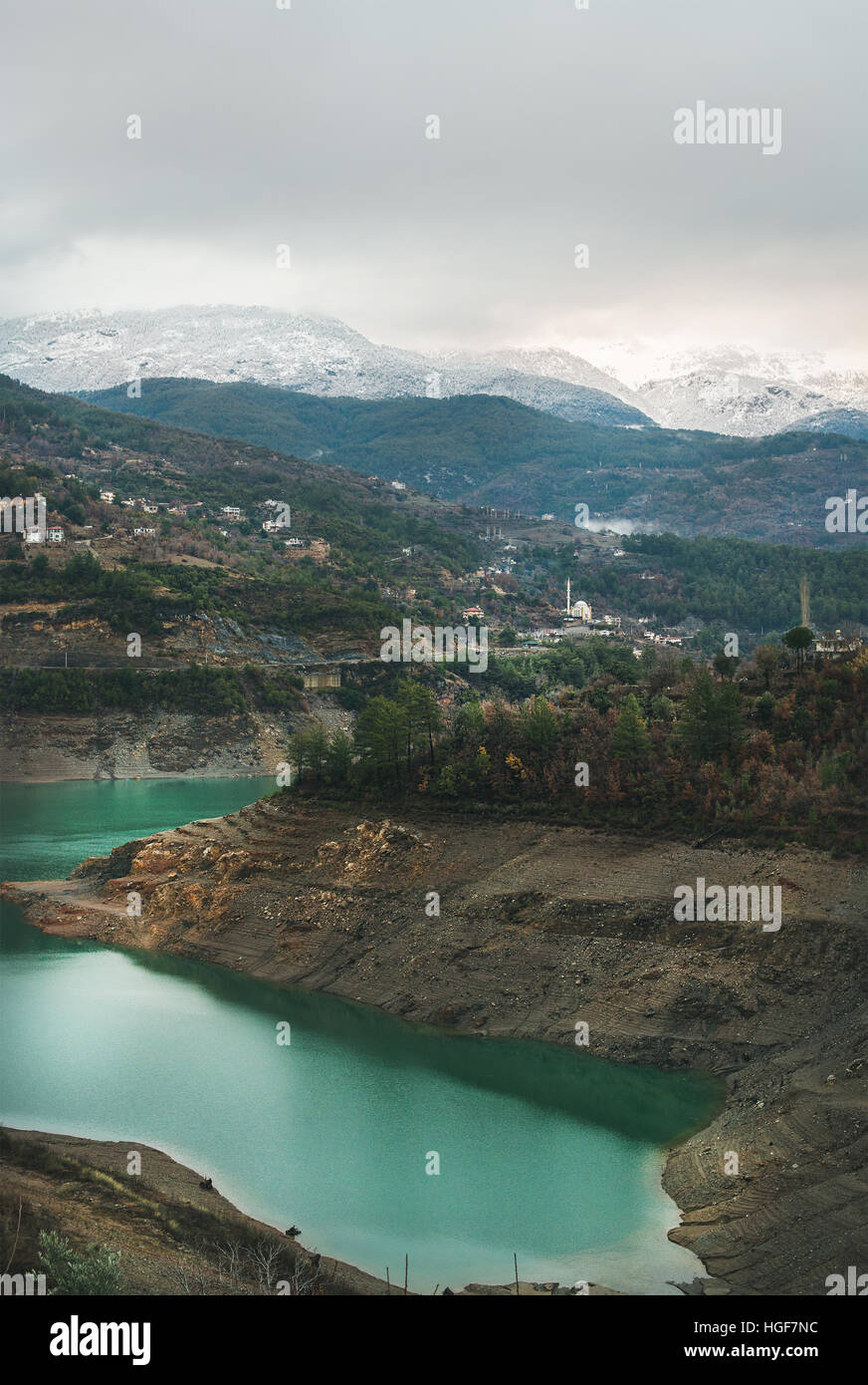 Landscape with green Dim Cay storage pond in mountains, Turkey - Stock Image