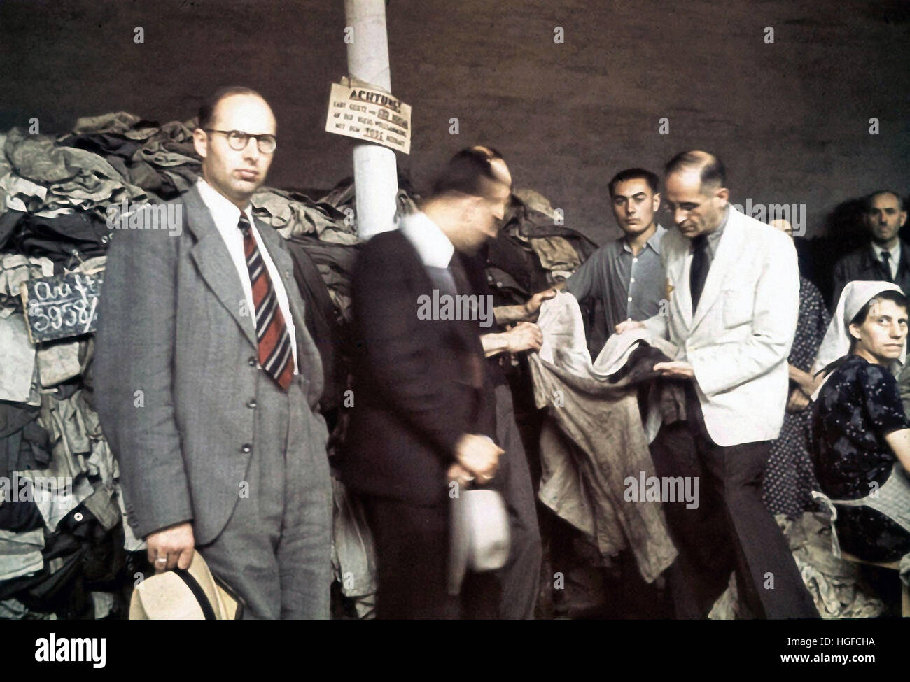 Ghetto Lodz, Litzmannstadt, German officials are checking clothes in the warehouse, Poland 1942, World War II, - Stock Image