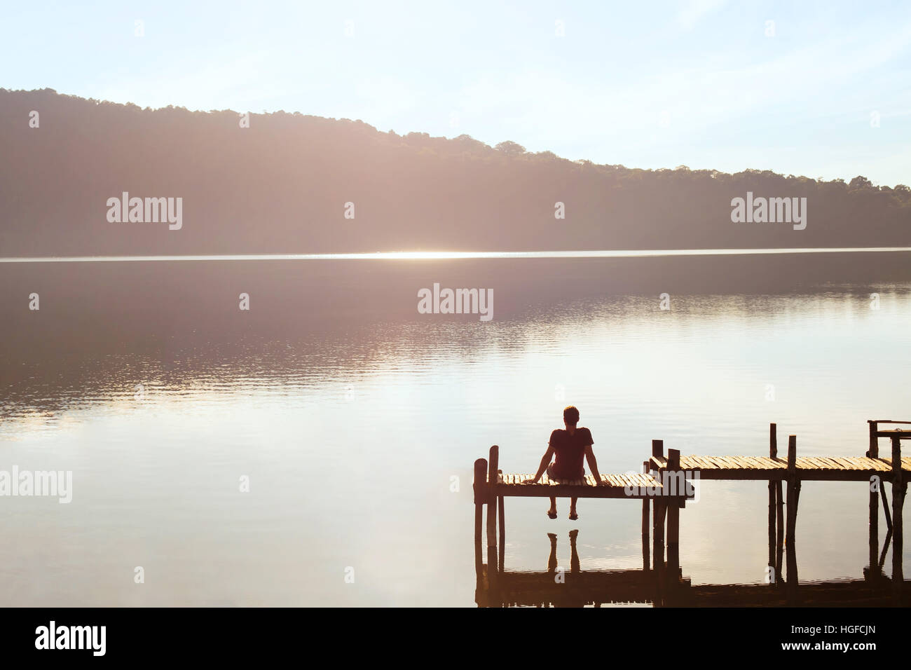 happy people, daydreamer, man enjoying beautiful view of the lake, inspiration in nature - Stock Image