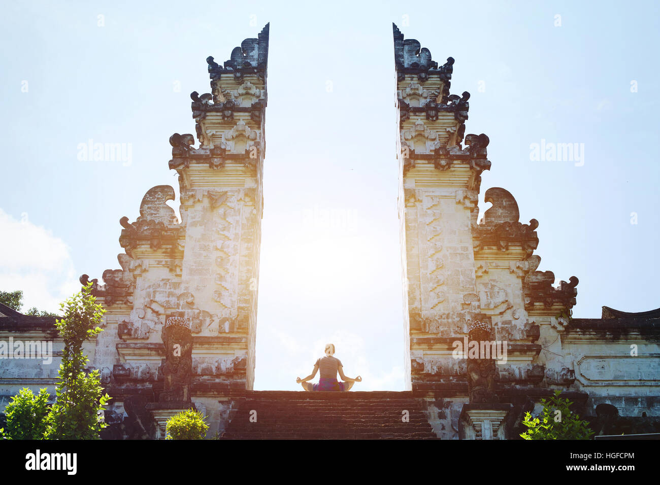 yoga in Bali, meditation in the temple, spirituality and enlightenment - Stock Image