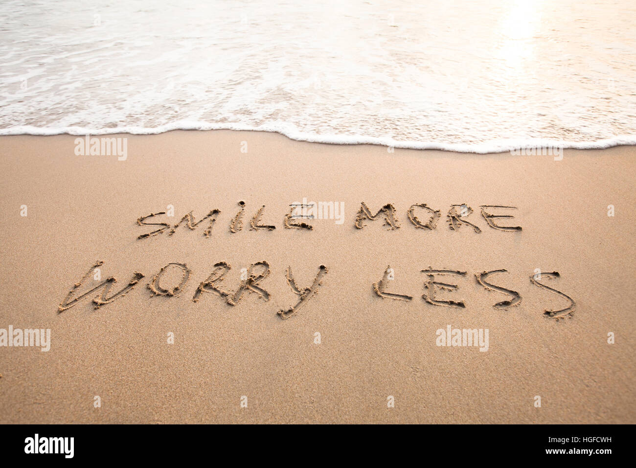smile more worry less - positive thinking concept, optimism - Stock Image
