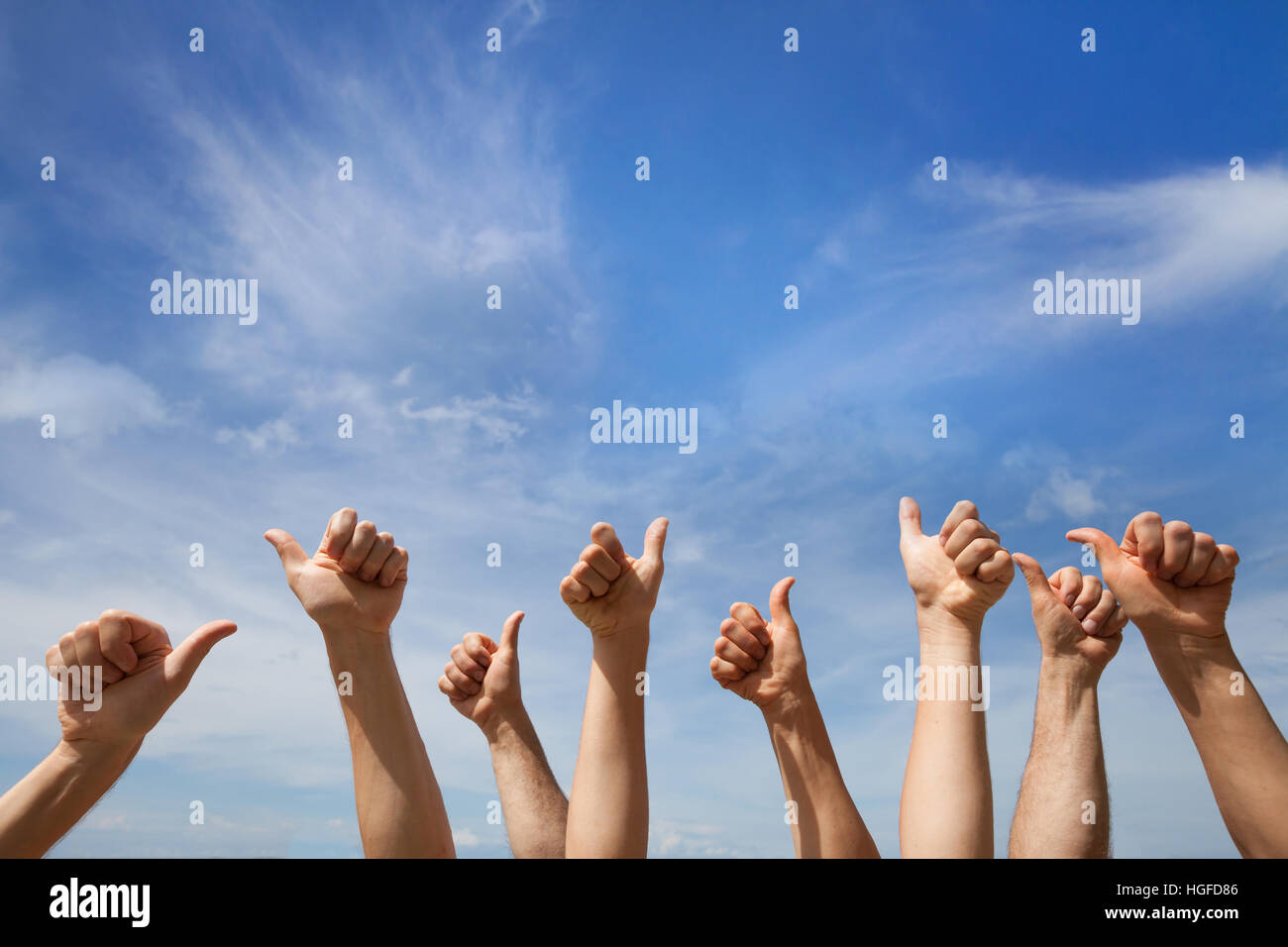 like concept, many hands showing thumb up or ok sign on blue sky background - Stock Image