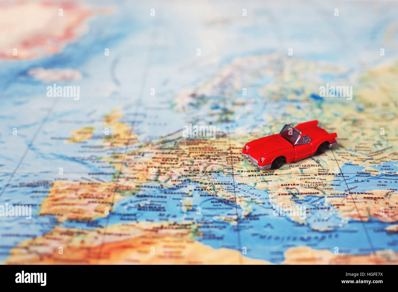 rent car concept, rental vehicle, toy on the map - Stock Image