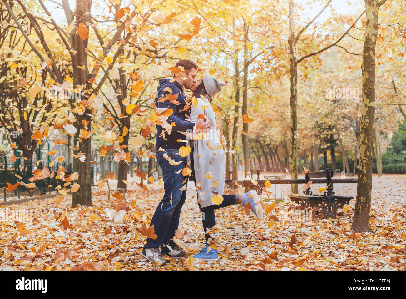 couple kissing in autumn park, fall - Stock Image