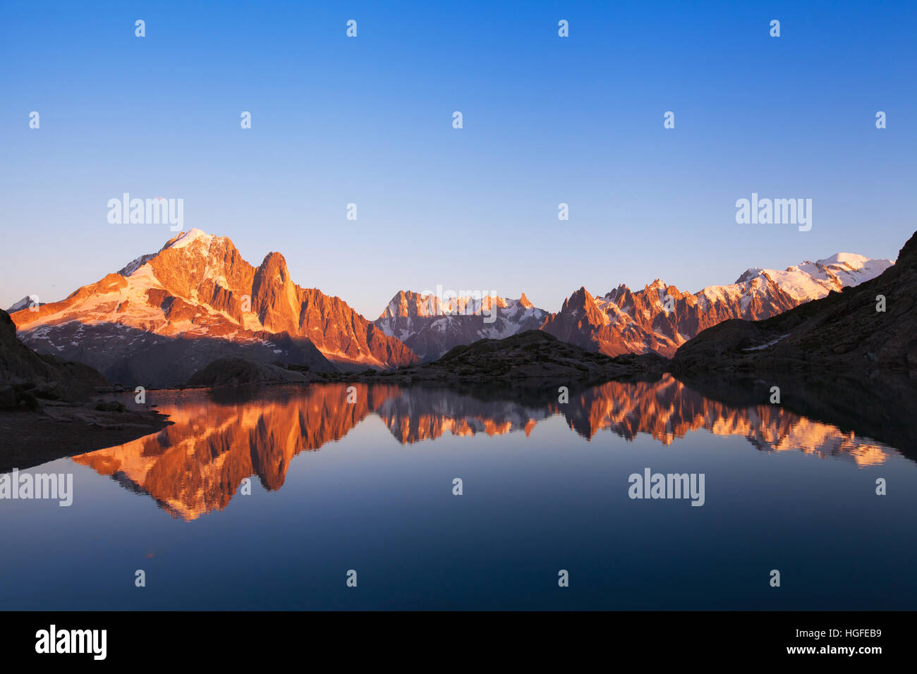Beautiful Nature Background Mountain Landscape At Sunset Panoramic View Of Alps With Reflection In Lake