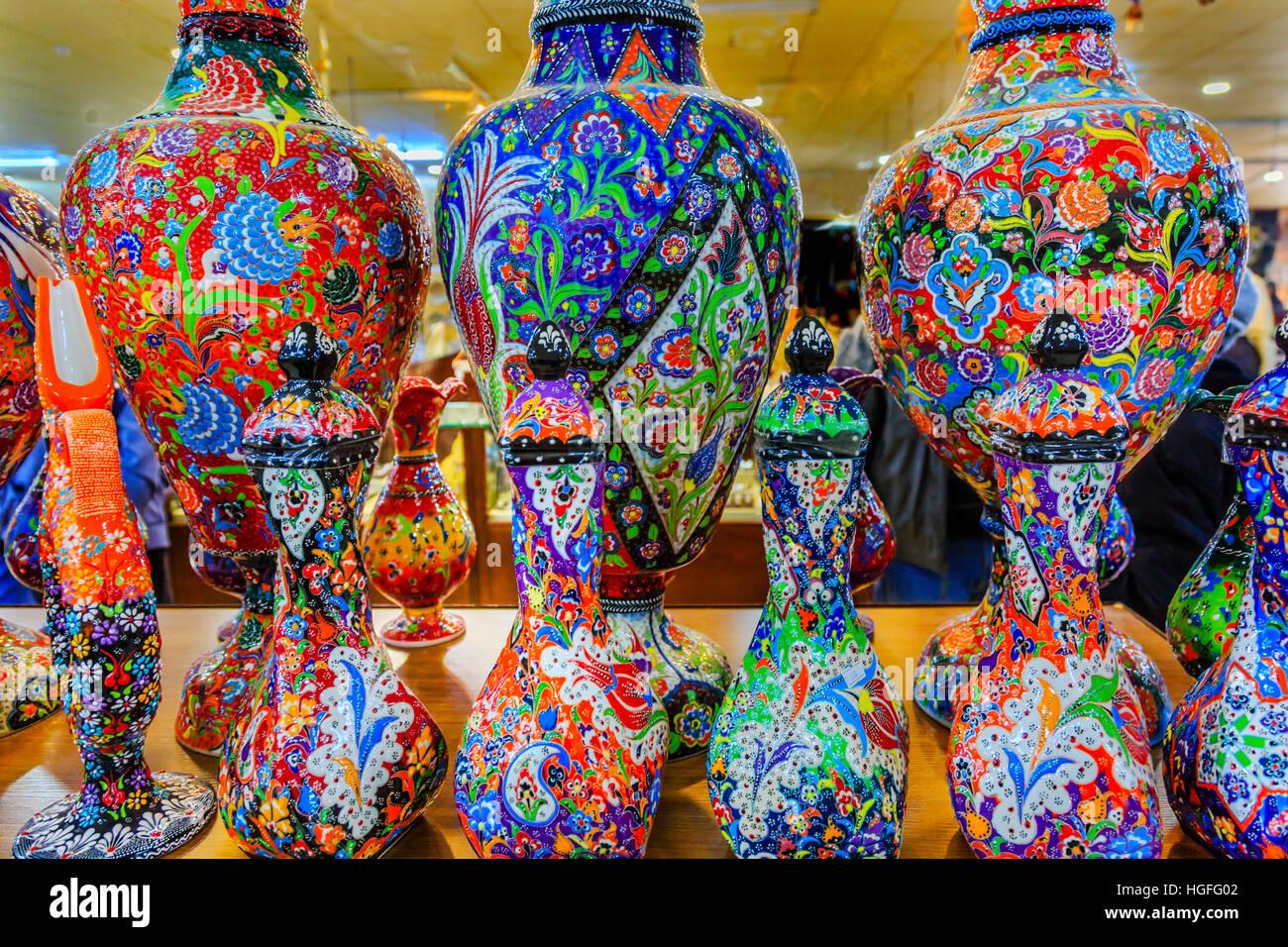 Ancient Arab Islamic Red Blue Orange Flower Designs Pottery Vases Madaba Jordan - Stock Image