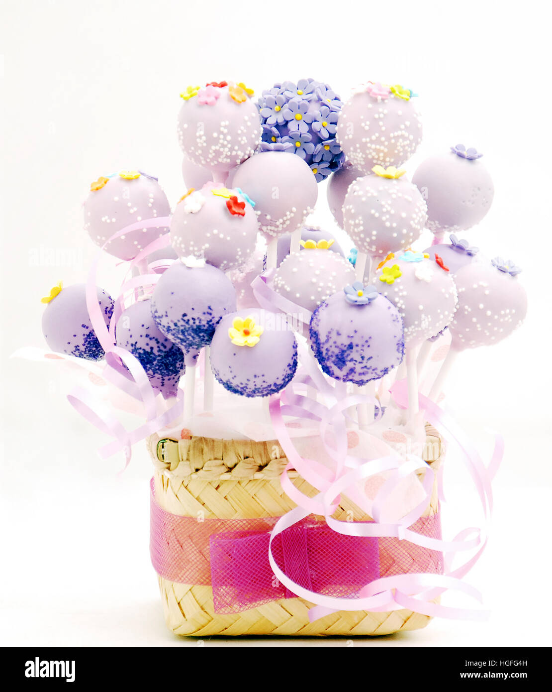 Cake pop bucket, a bunch of cake pops  decorate with webbing from bambo, with a ribbon - Stock Image