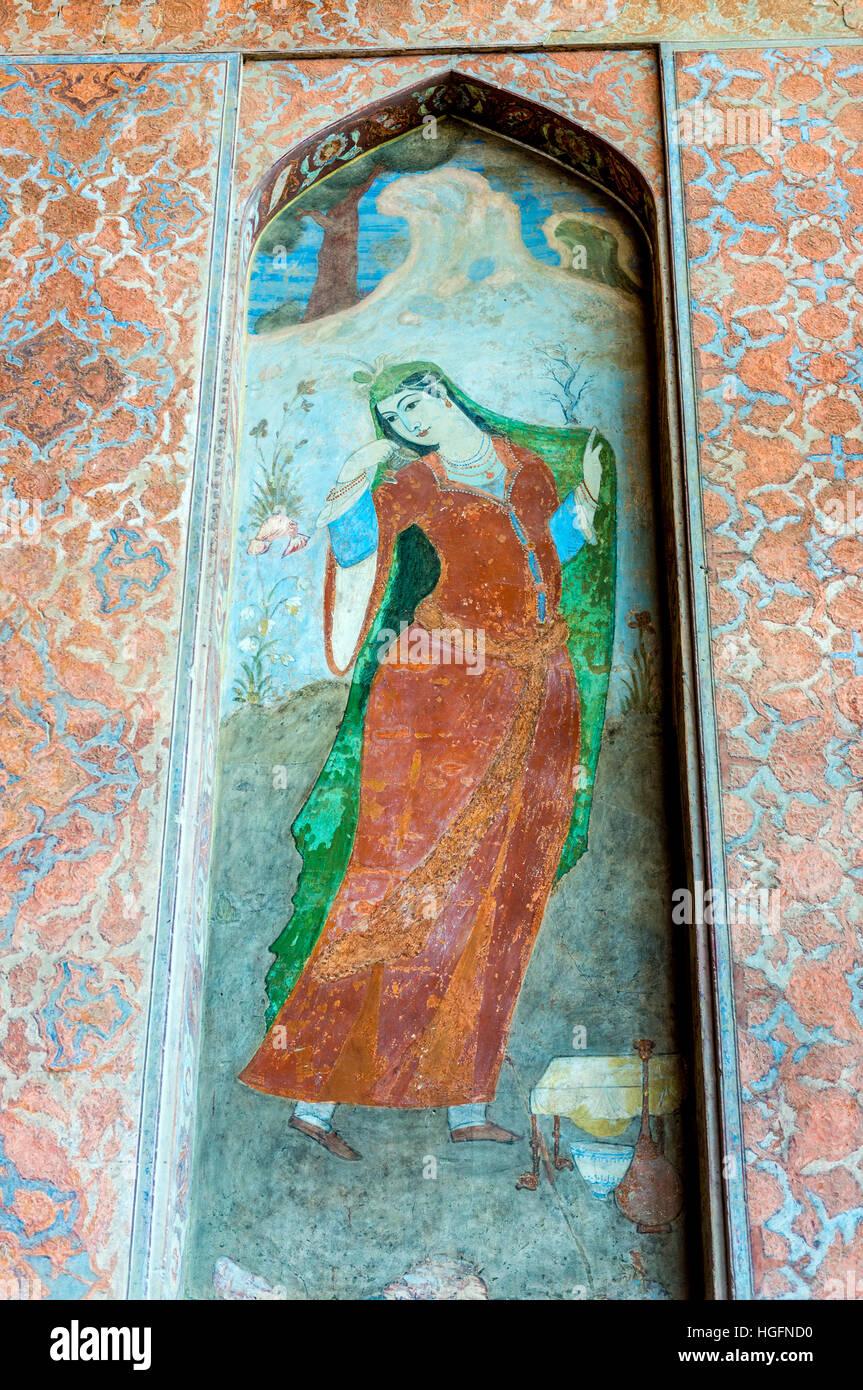Painting of Persian woman in Safavid grand palace Ali Qapu located at Naqsh e Jahan Square in Isfahan in Iran Stock Photo