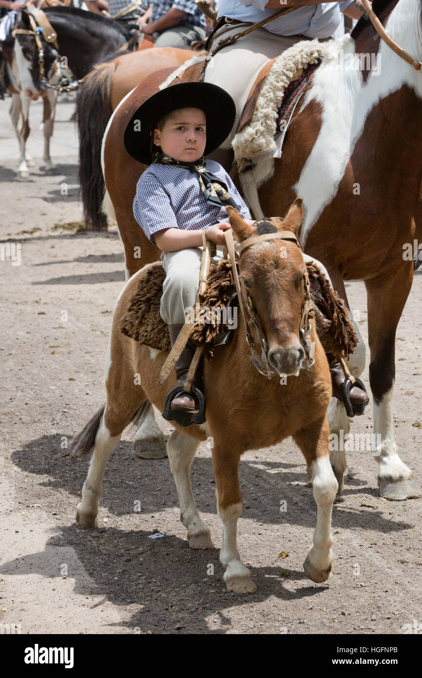 Young gaucho at gaucho parade on the Day of Tradition, San Antonio de Areco, La Pampa, Argentina, South America - Stock Image