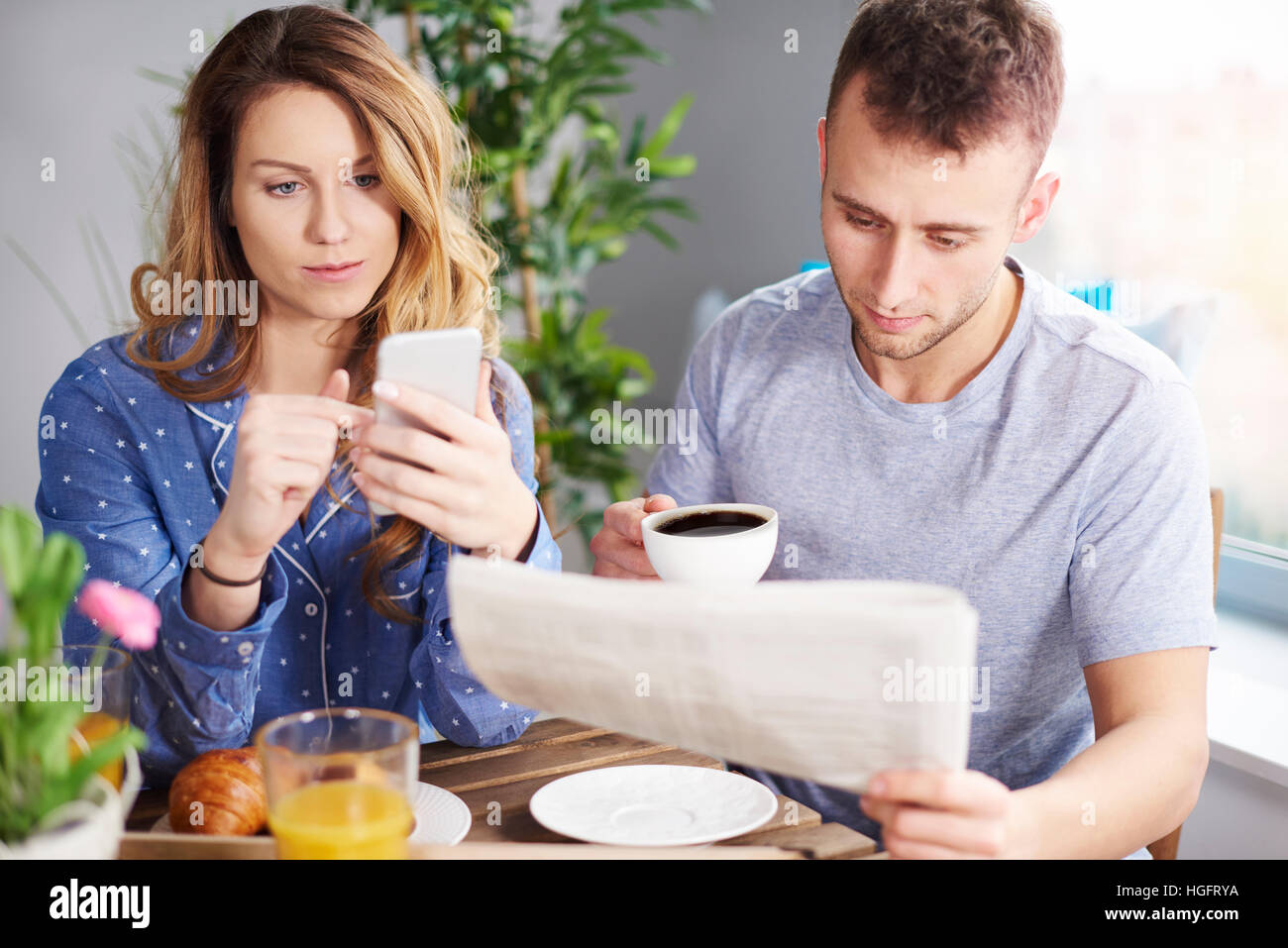 Couple enjoying breakfast in dining room Stock Photo