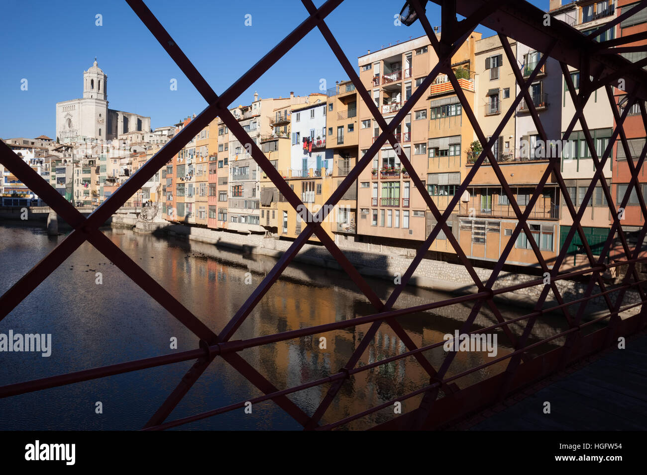 Spain, Catalonia, Girona, Old Town houses along the Onyar River, view through the Eiffel Bridge, abstract urban - Stock Image