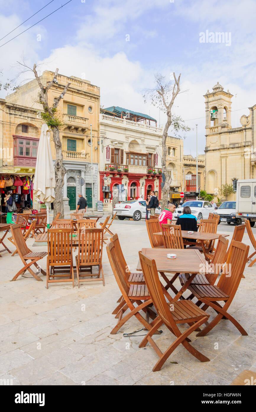 VICTORIA, MALTA - APRIL 11, 2012: Street scene, with locals and visitors, in Victoria, Gozo Island, Malta - Stock Image