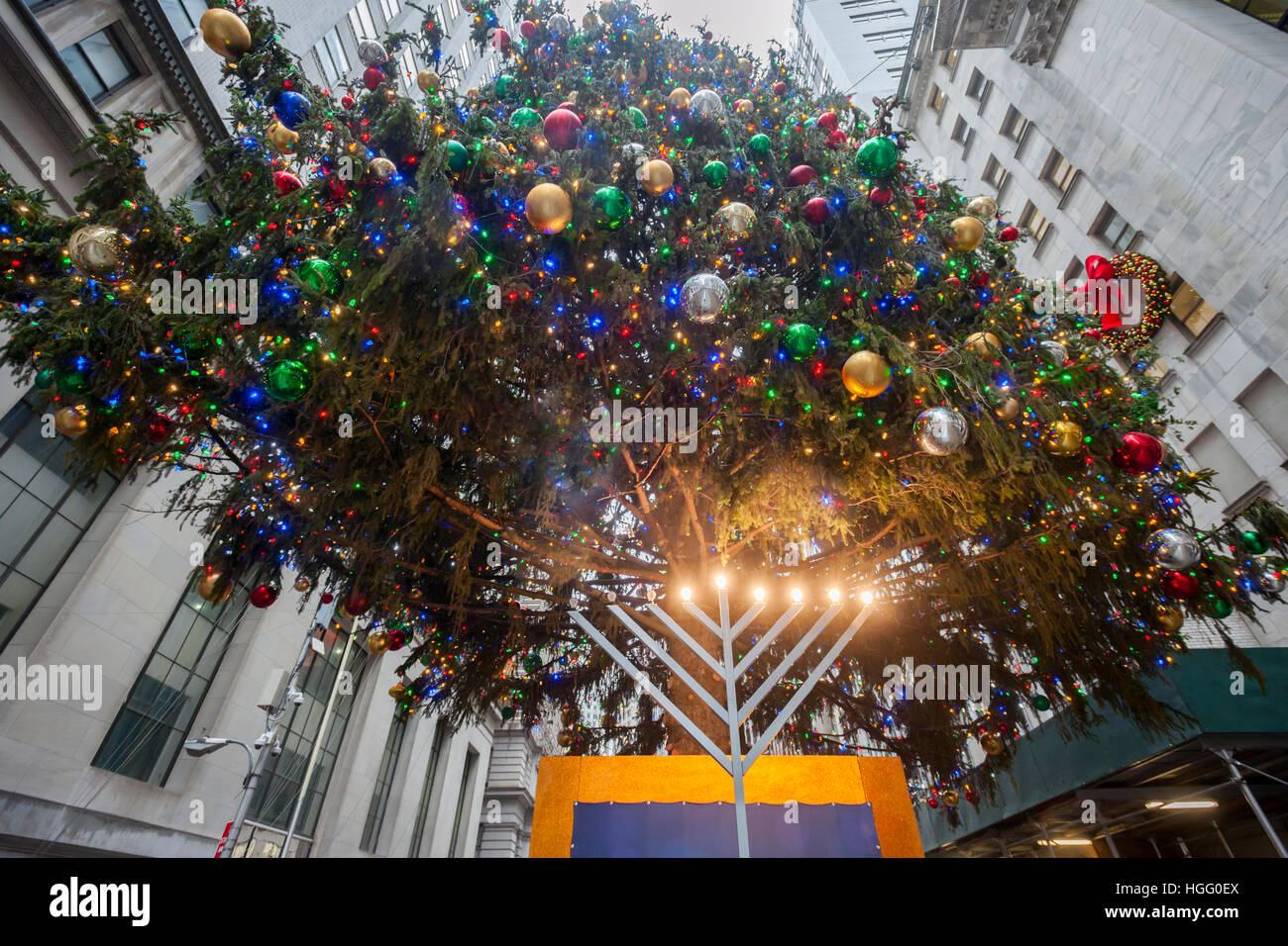 The New York Stock Exchange Christmas tree towers over their Chanukkah Menorah on Thursday, December 29, 2016. (© - Stock Image