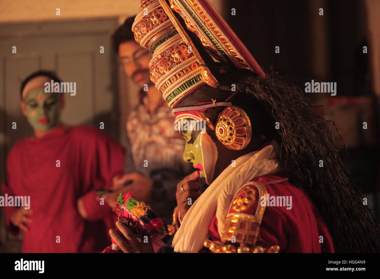 kathakali artist applying makeup - Stock Image