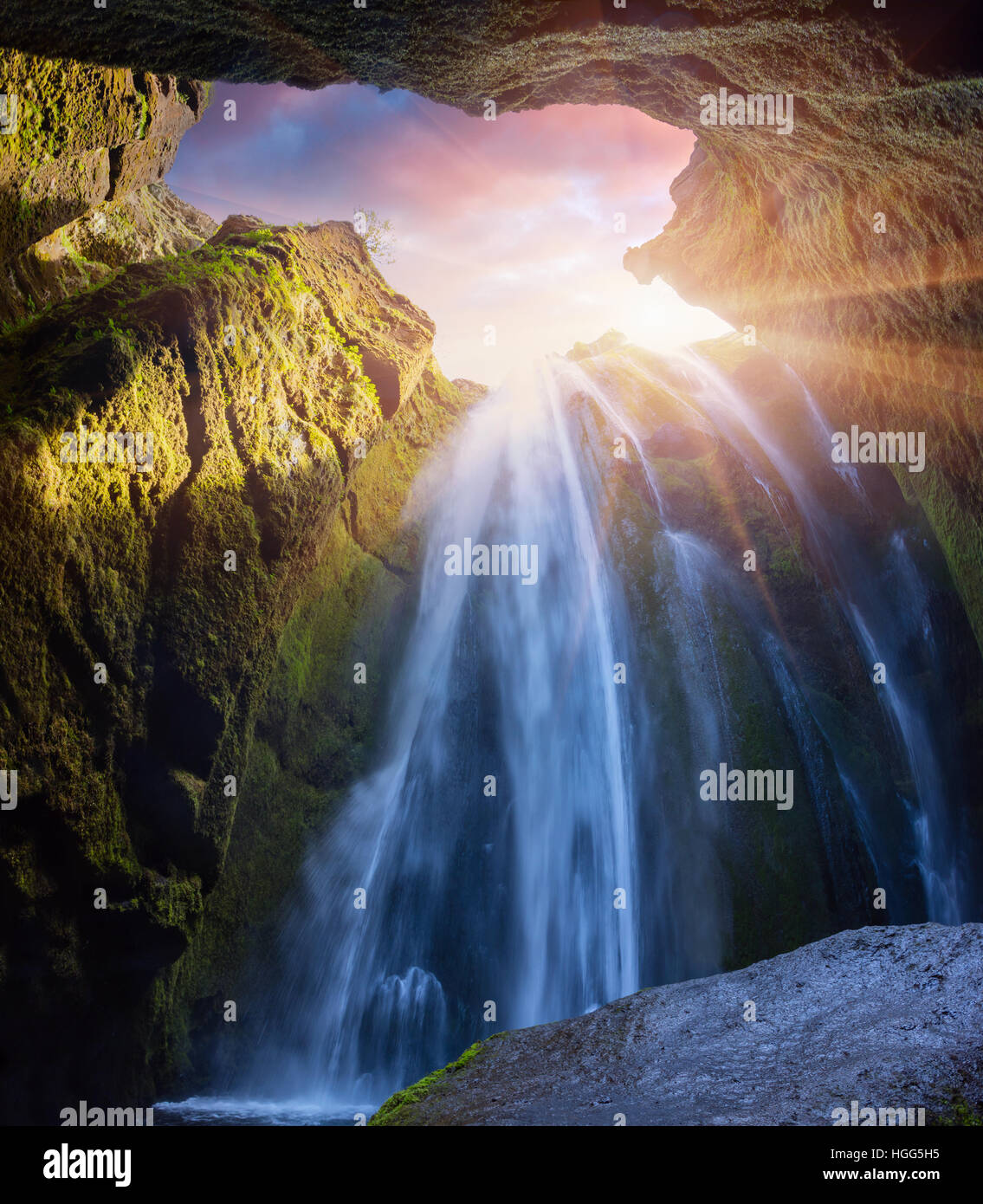 Bottom view of beautiful waterfall - Seljalandfoss. Colorful summer sunrise in canyon in Iceland, south region, - Stock Image