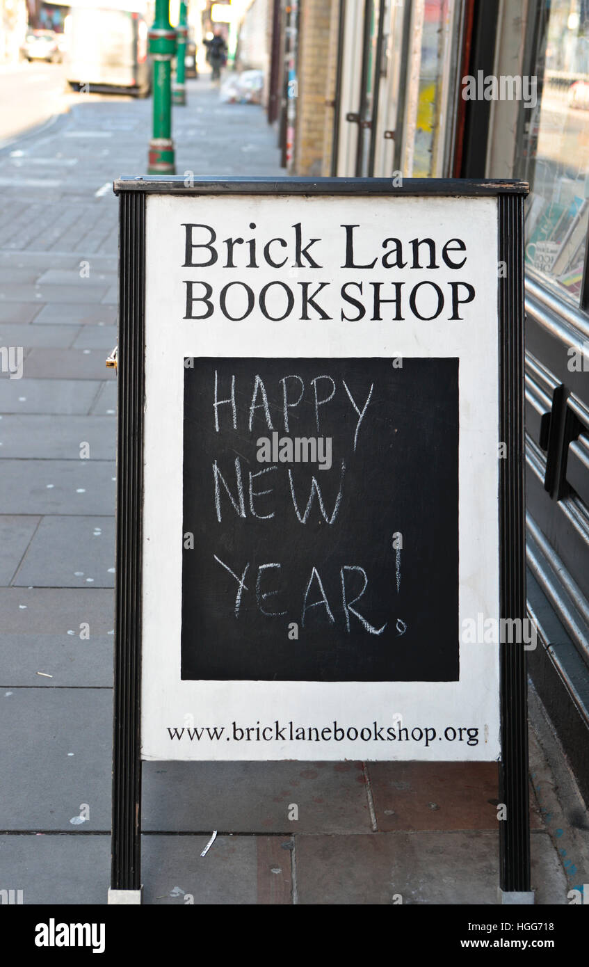 Happy New Year message on Brick Lane Bookshop. London.Uk - Stock Image