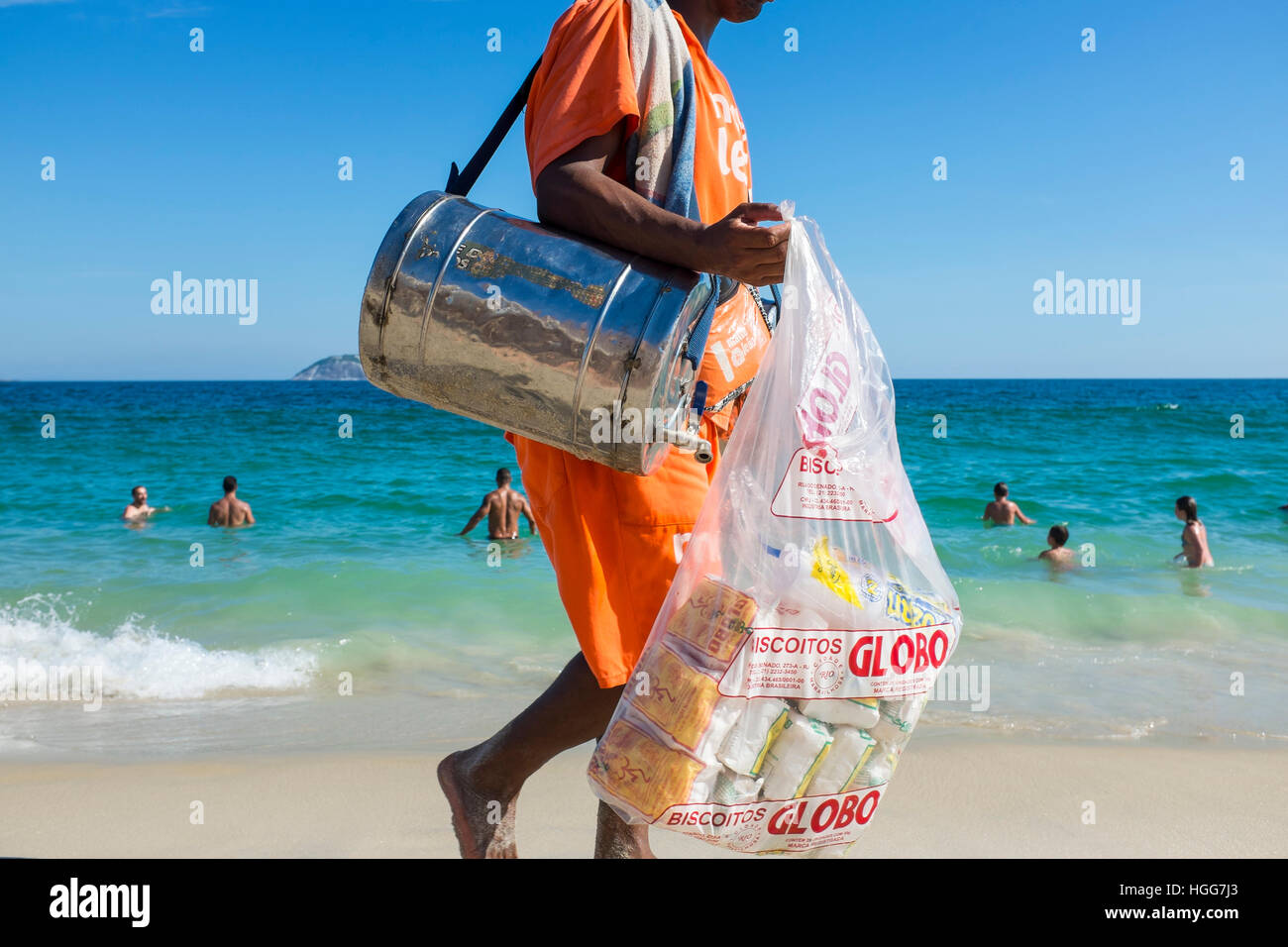 RIO DE JANEIRO - FEBRUARY 26, 2016: Beach vendor selling mate, the South American tea, and Globo brand biscuits, - Stock Image