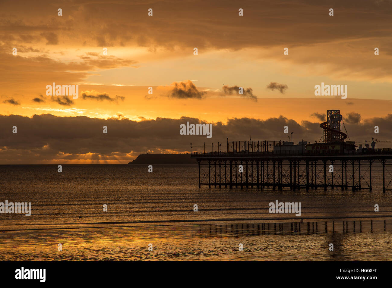 paignton pier with sunrising, - Stock Image