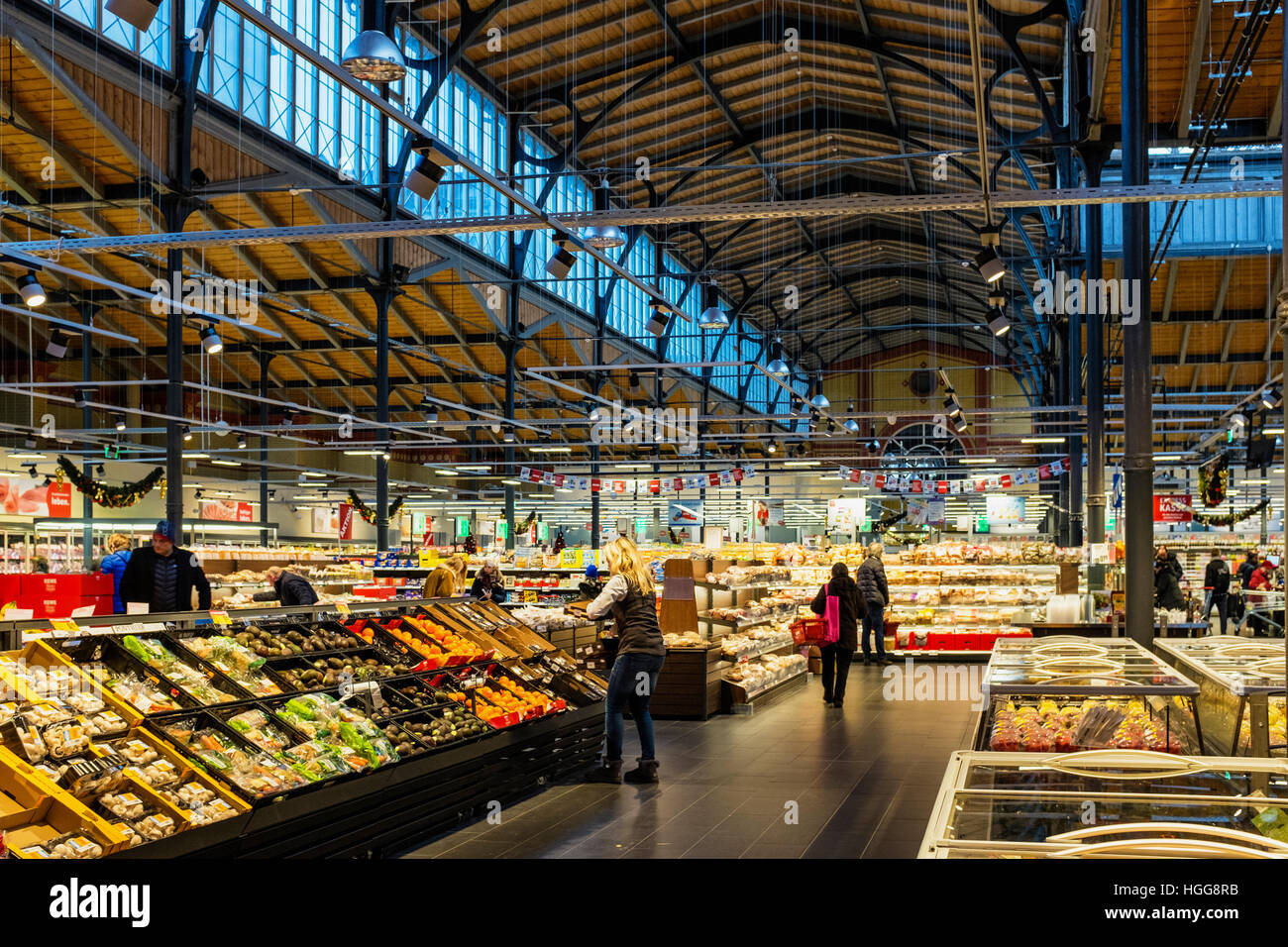 Rewe Supermarket fridges and shoppers in beautiful newly renovated old market hall building, Invalidenstrasse, Mitte, - Stock Image