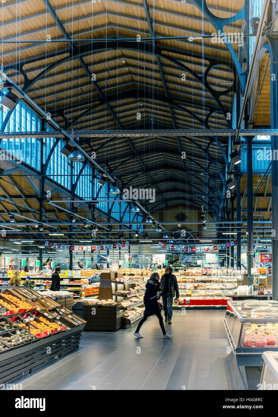 Rewe Supermarket aisle and shoppers in beautiful newly renovated old market hall building, Invalidenstrasse, Mitte, - Stock Image