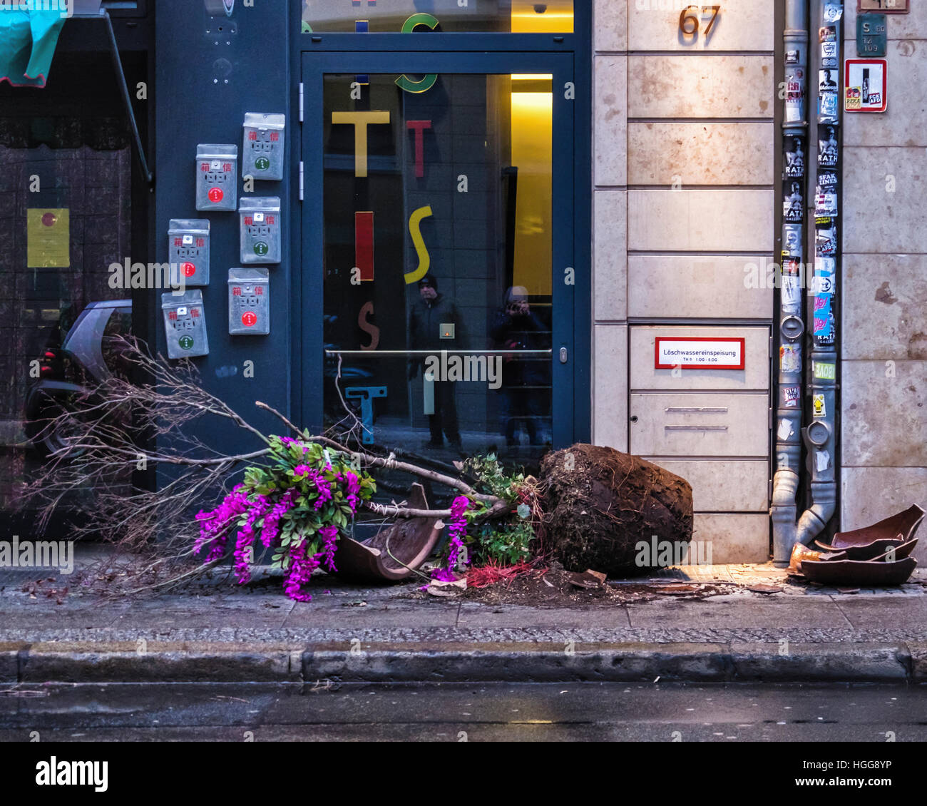 Berlin, Mitte. Vandalism. Vandalised, broken plant pot on city street pavement - Stock Image