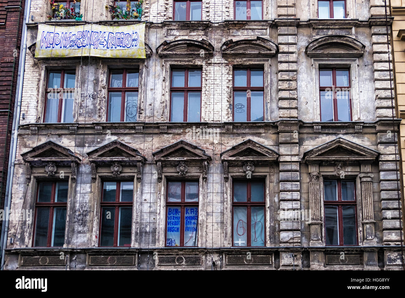Berlin, Mitte. Old historic building needing refurbishment with political message on banner - Stock Image