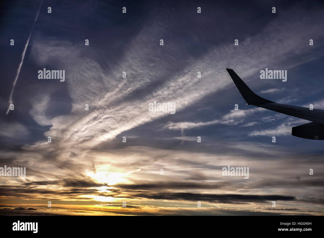 Sunrise, sun rising, golden sky, dawn, view from plane, airplane - Stock Image