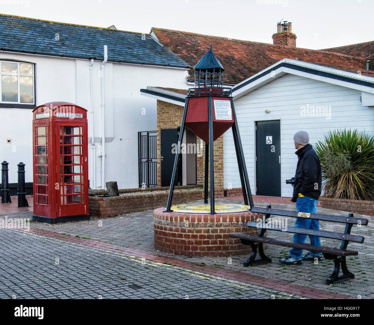 Burnham on Crouch,Essex, England.  Man looking at Old Maplin Lighthouse model at Riverside village & holiday - Stock Image