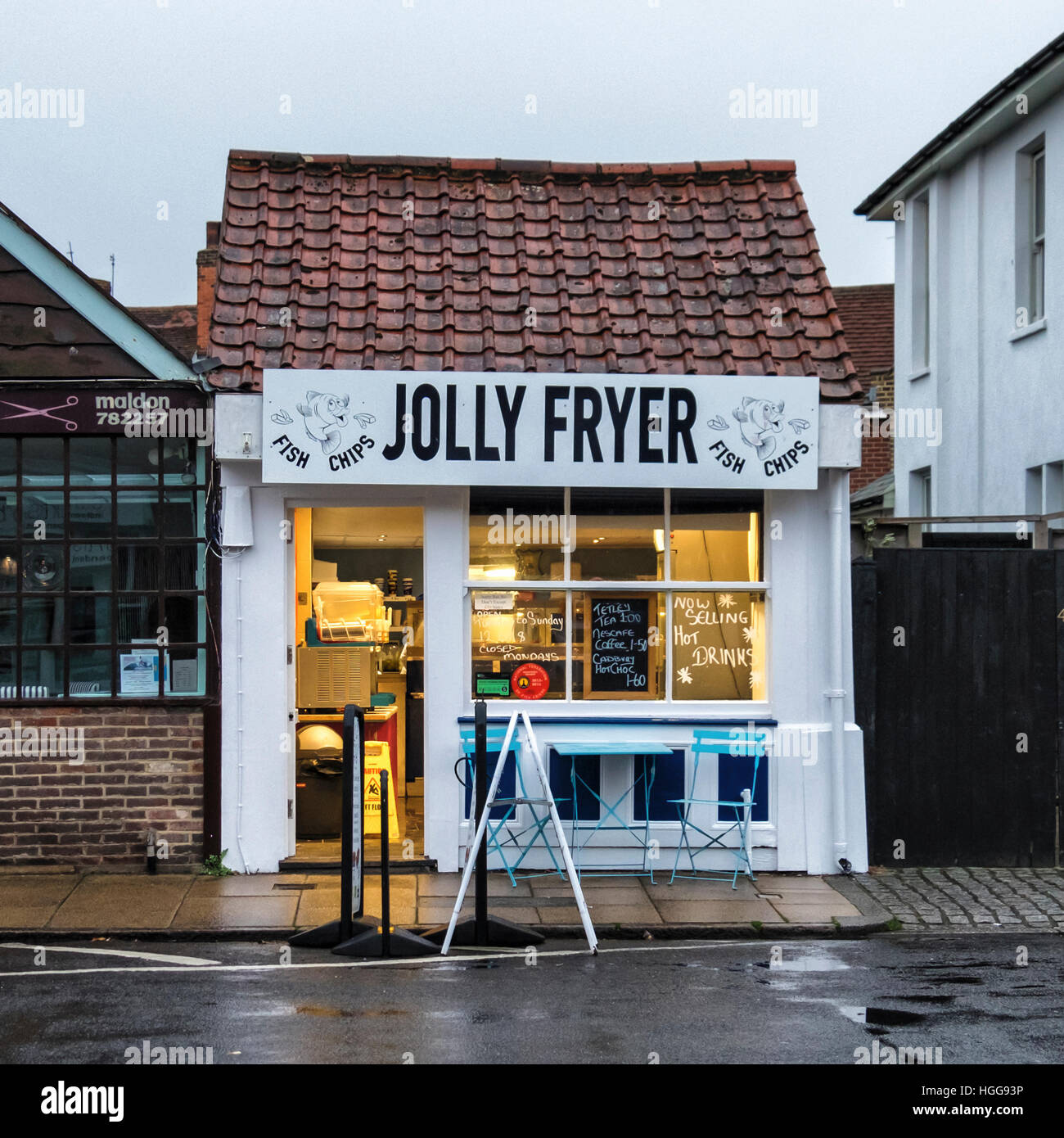 Jolly Fryer Fish and Chips take-away shop, fast food outlet, diner in old cottage building. Burnham-on-Crouch, Essex, - Stock Image
